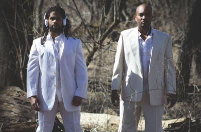 Duane Lee Holland Jr. and Maurice Watson stand outdoors