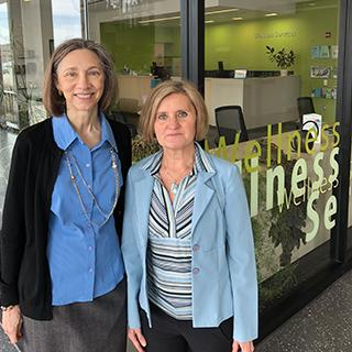 health coaches standing near wellness office