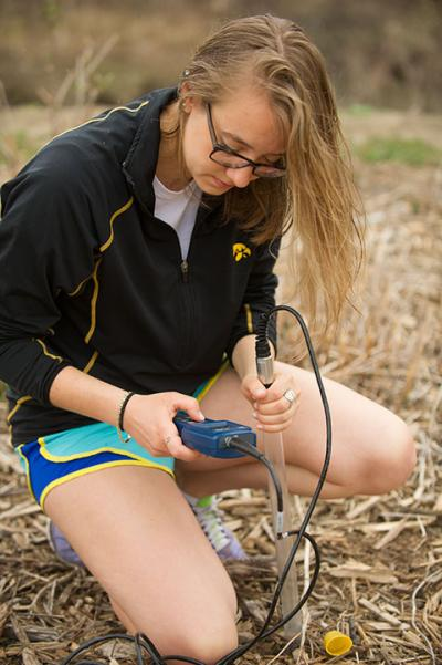 Kelsey Zlevor takes a water sample reading.