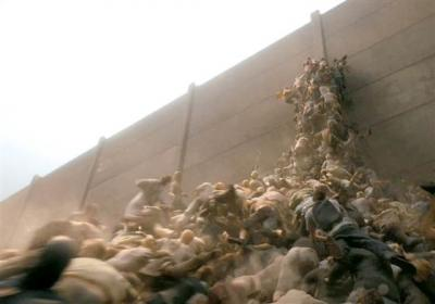 "A scene from the movie ""World War Z"" that shows people trying to escape over a wall to get away from zombies. Image courtesy of Paramount"