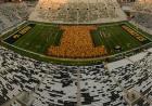 "first-year students form a ""block I"" on the Kinnick Stadium field"