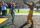 Student with Herky mascot.