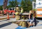 A dummy victim is examined by an EMT.