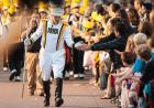 drum major walking in homecoming parade