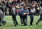 Officials split up for the kickoff.