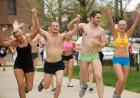 runners participate in the Nearly Naked Mile