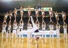Cheerleaders forming a pyramid.