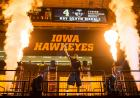 Iowa basketball player surrounded by fireworks.