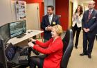 State Sen. Liz Mathis takes one of the mini-sims for a spin at the National Advanced Driving Simulator Thursday while others look on.