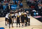 The Iowa men's basketball team huddling on the court.