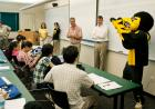 Herky in front of students in classroom