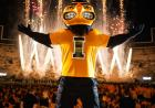 Mascot Herky with fireworks in the background.