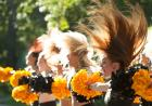 Cheerleaders with hair flying.