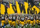 Iowa football team runs onto the field.
