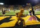 Mascots stage a sword fight in the end zone.