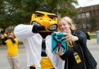 While the Hawkeye Marching Band entertained the crowd outside the College of Pharmacy at lunchtime on Friday, 10/17, Herky and Jeanine Abrons, clinical assistant professor in the college, paused for a selfie.