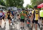Iowa riders walk their bikes through town.