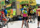 Riders wait for a beverage along the route