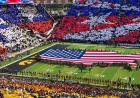 American flag on the field during card stunt