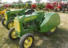 Rows of restored tractors on display.