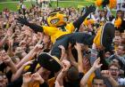 Herky mascot held aloft by the crowd.