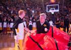 Iowa Head Coach Fran McCaffery pops out of a giant basketball.