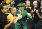 Iowa fans pose with the Notre Dame mascot.