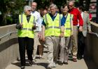 UI President Sally Mason leads dignitaries on a tour of flood preparations.