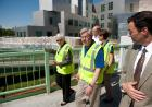 UI President Sally Mason leads officials on a tour of flood preparations.