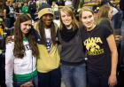 Iowa fans pose for pictures with Notre Dame team members.