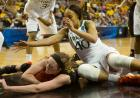 Iowa's Morgan Johnson protects the ball from Miami's Shawnice Wilson.