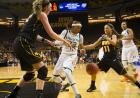 Iowa's Morgan Taylor and Trisha Nesbitt strip the ball from Miami's Suriya McGuire