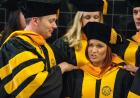 Graduate College students prepare for commencement.