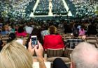 Parents snap a photo of commencement.