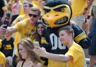Herky poses with fans for photos.