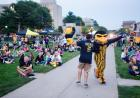 Herky celebrates the Hawkeyes with a fan during the Beat State Pep Rally.