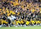Team and fans celebrating win at Kinnick