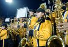 Tenor sax section of the marching band in the stands.