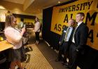 new president posing for pictures at alumni event