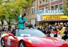 homecoming court candidate waves to crowd outside Englert Theatre