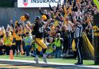george kittle celebrating a touchdown catch