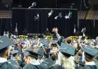 caps flying at commencement ceremony