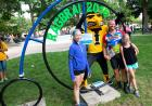 people with Herky by RAGBRAI sign