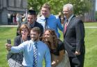 Graduates and their families celebrating commencement on the Pentacrest