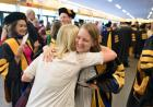 embracing at commencement