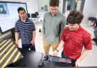 three students working in engineering annex
