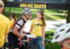 university of iowa staff member lends assistance to a ragbrai rider on the university of iowa campus