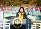 flags representing the home countries of university of iowa international students fly on the IMU footbridge; uisg president hira mustafa speaking at ceremony