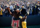 mascots embracing during the wave