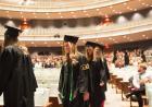 grads in file in hancher auditorium